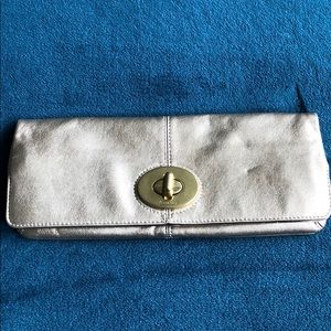 Coach gold clutch bag. New without tags